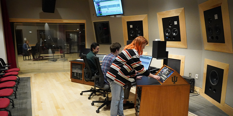 Students recording in the Georgina Joshi Recording Arts Studio.