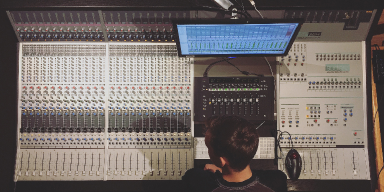Student working at a mixing console