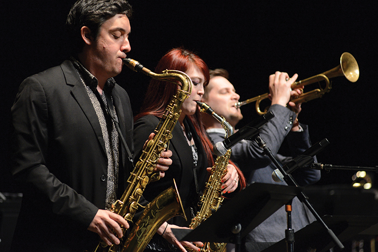 Image from IU Jacobs Jazz concert featuring two students and John Raymond performing a trio.